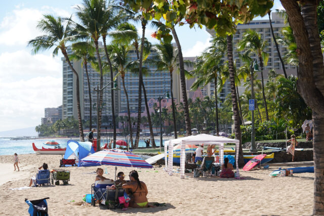 Families gather under tents at Waikiki Beach. Aug, 6 - Following a continued surge of COVID-19 cases and deaths, Mayor Caldwell's Emergency Order 2020-23 includes the closure of City parks, most park facilities, all campgrounds, Botanical Gardens, and Community Gardens from Saturday, August 8 through Friday, September 4, 2020.