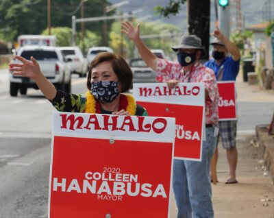 Honolulu Mayor candidate Colleen Hanabusa waves to cars in Nanakuli, HI, Friday, August 7, 2020. (Ronen Zilberman photo Civil Beat)