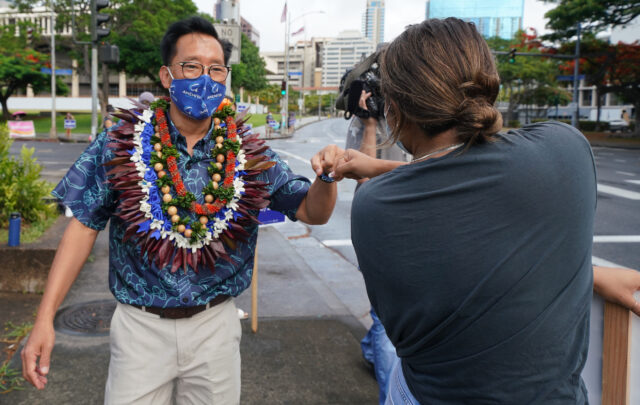 Honolulu Mayoral Candidate Keith Amemiya greets his supporters on the corner of Punchbowl and Beretania Street. August 8, 2020.