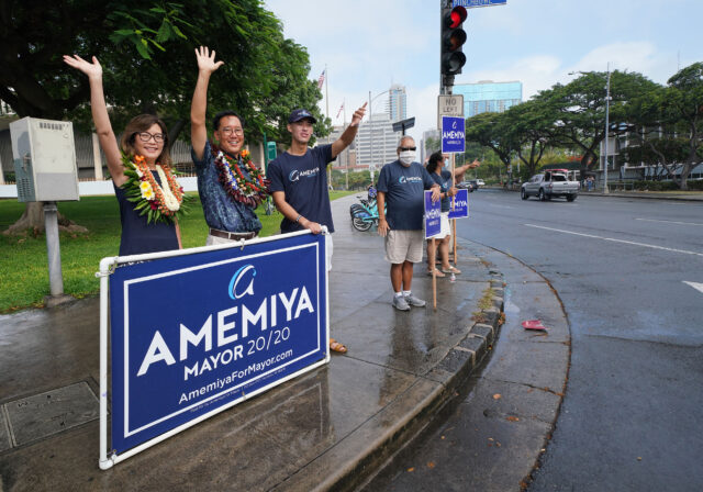 Honolulu Mayoral Candidate Keith Amemiya with left, wife Bonny Amemiya and son, Christopher Amemiya on the corner of Punchbowl and Beretania Street. August 8, 2020
