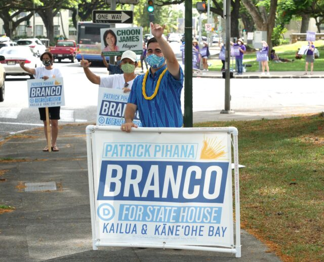 State House candidate for Kailua and Kaneohe Bay, Patrick Branco waves to cars on the corner of Beretania and Punchbowl in Honolulu, HI, Saturday, August 8, 2020. (Ronen Zilberman photo Civil Beat)