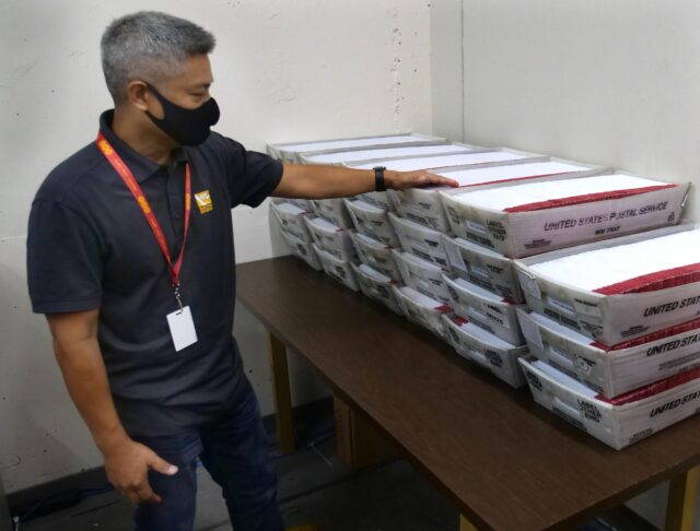 "Honolulu City & County Elections Administrator, Rex Quidilla, points to ballots that arrived from the post office to the city elections office to be verified on Friday August 7, 2020. Quidilla said ""the (ballot) turnout record is being broken as we speak."" (Ronen Zilberman photo Civil Beat)"
