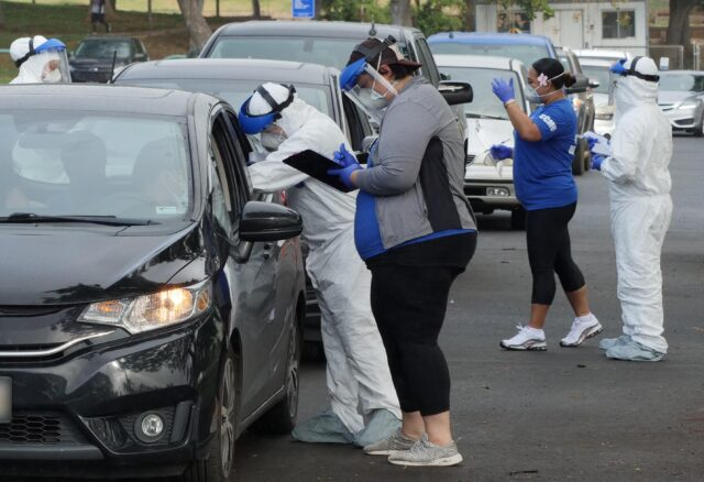 Medical technicians from Premiere Medical Group Hawaii check vitals of residents in their cars before collecting swab samples for COVID-19 tests, during a drive-thru event, in the Kaka'ako district of Honolulu, HI, Sunday, August 9, 2020. (Ronen Zilberman photo Civil Beat)