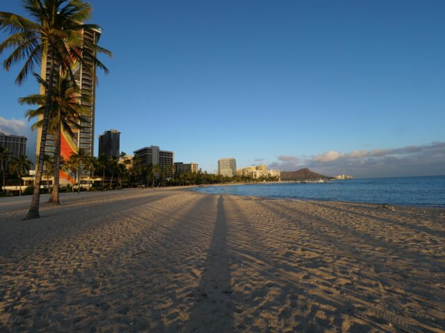 Empty beach in Waikiki at sunset on Monday, August 10, 2020 due to statewide closures to curb increases in COVID-19 cases. (Ronen Zilberman photo Civil Beat)