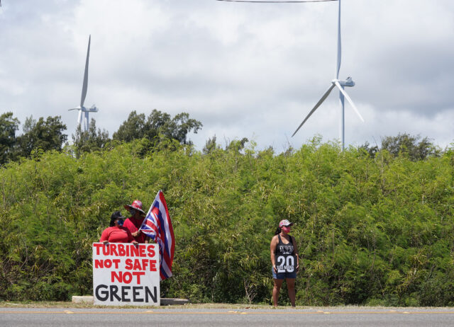 Opponents of the Kahuku windmills socially distance along Kamehameha Highway.
