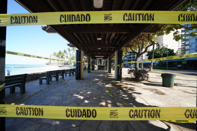 Parks Closed along Waikiki Beach, covered benches along Kalakaua Avenue have yellow tape during COVID19 surge in Honolulu. August 12, 2020