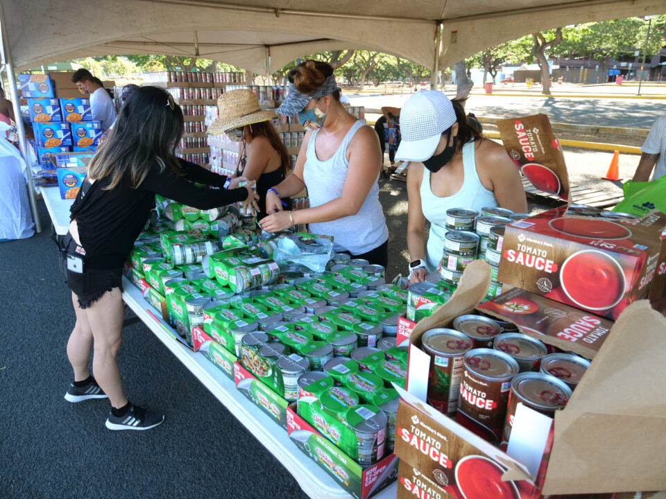 Volunteers from the HLTA (Hawaii Lodging & Tourism Assoc.) and Aloha Harvest organize food donations for a drive-thru distribution event, at Aloha Stadium, Friday, August 14, 2020. The event has prepared 1,000 food bundles for hospitality workers and their families. (Ronen Zilberman photo Civil Beat)