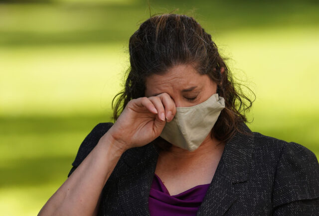 State of Hawaii Dept of Health Epidemiologist Dr. Jennifer Smith, PhD wipes away tears at the press conference with CongresswomanTulsi Gabbard. August 14, 2020