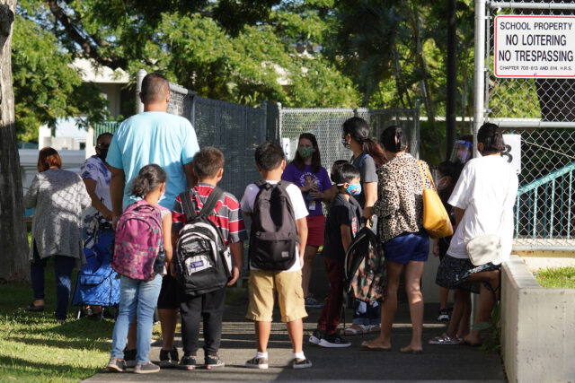 Kauluwela Elementary School students and parents arrive during the COVID-19 pandemic. August 17, 2020