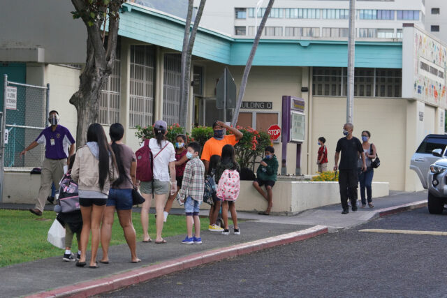 Kauluwela Elementary School students and parents arrive for first day of in person instruction during a COVID-19 pandemic. August 17, 2020