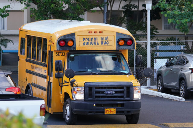 Roberts School Bus travels thru a parking lot to pick up some students. August 17, 2020