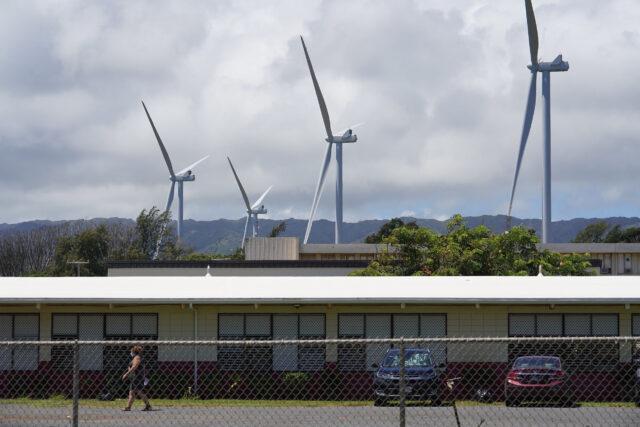 Windmills tower over Kahuku High School.