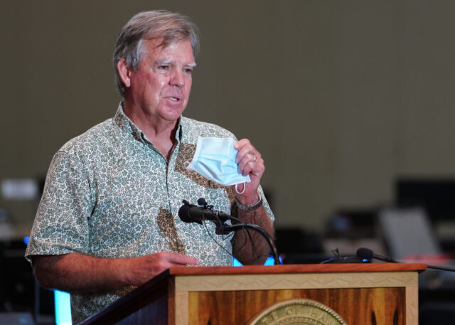 Department of Health Director Dr. Bruce Anderson holds mask and emphasizing the use of mask and being vigilant during contact tracing press conference held at the Hawaii Convention Center. August 19, 2020
