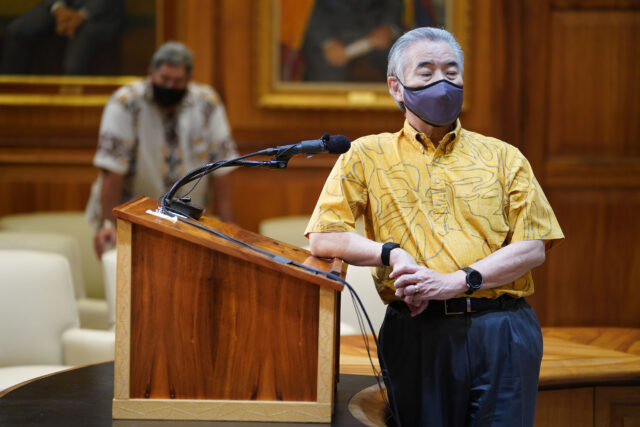 Governor David Ige leans on podium during a joint press conference with Mayor Kawakami and Mayor Victorino during COVID-19 pandemic. August 20. 2020