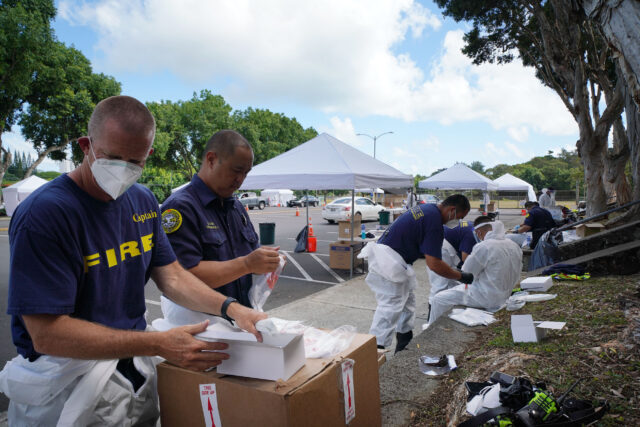Kaneohe District Park COVID19 surge testing with HFD Fire Department firefighters assisting with unused test kits. August 26, 2020