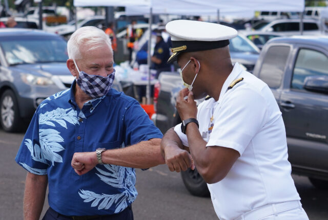 Vice Admiral Jerome Adams, US Surgeon General gives an elbow bump to Mayor Kirk Caldwell at the conclusion of the COVID-19 surge testing press conference held at Leeward Community College parking lot. August 26, 2020