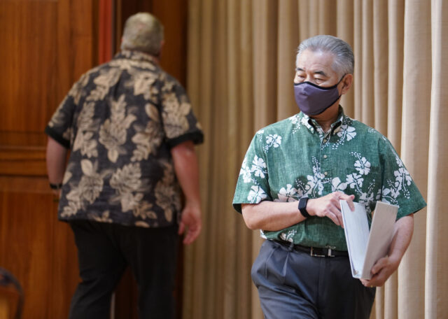Masked Governor David Ige walks into press conference discussing veto some measures during COVID-19 pandemic. August 31, 2020