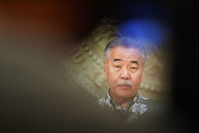 Governor David Ige seen with video photographer in foreground, during press conference in the Ceremonial room. August 31, 2020