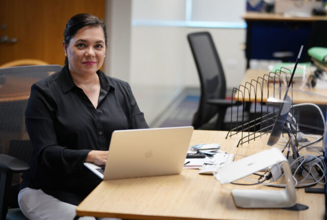 Honolulu Civil Beat Lee Cataluna sits at her desk on her first day of work.