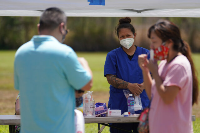 Medical personnel assist with self swabbing during surge COVID-19 testing held at Kalihi Valley District Park. September 4, 2020