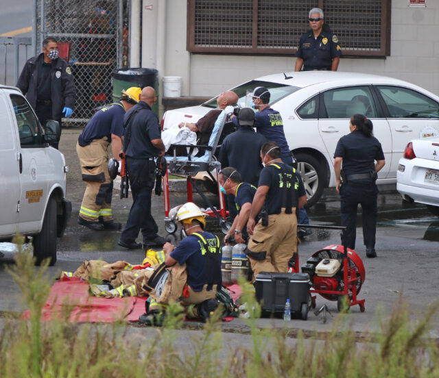 Hawaii County Firemen place an inmate on a gurney after inmates caused an affray late Tuesday with a fire and barricade at Hilo's HCCC correctional center. Photo: Tim Wright