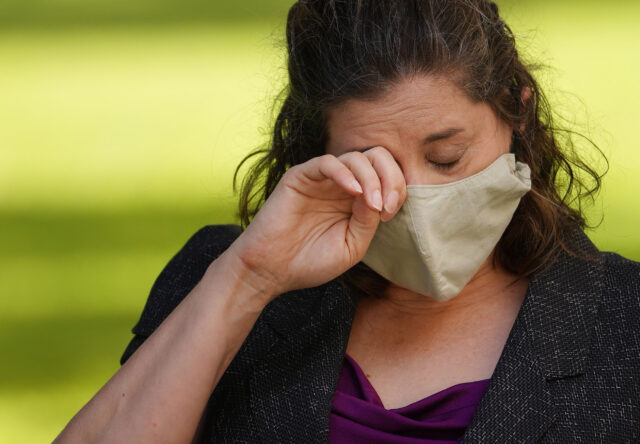 Department of Health Epidemiologist and whistleblower Jennifer Smith wipes away tears during press conference held with Tulsi Gabbard on August 14, 2020.