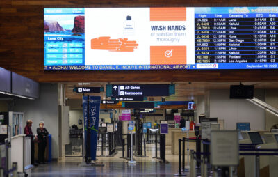 Electronic signs telling people to 'wash your hands' at the Daniel K. Inouye International Airport Interisland terminal during COVID-19 pandemic. September 18, 2020