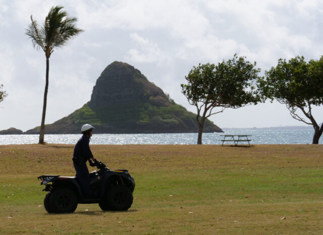A police officer patrols Kualoa Park on an ATV as parks prepare to reopen, to the public, for usage with some restrictions, Wednesday, Sept. 23, 2020. (Ronen Zilberman photo Civil Beat)