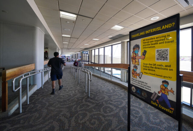 Sign outlining the need to check into the website 'travel.Hawaii.gov' at the Daniel K. Inouye International Airport, interisland terminal. Once travel arrangements are logged into the site, a QR code is issued and needed when arriving into the different airports during COVID-19 pandemic. September 23, 2020