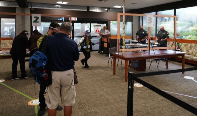 Hilo Police at exit and quarantine check in at HIlo Airport during COVID-19 pandemic. All arriving passengers were subject to a 14-day mandatory quarantine on Hawaii island. September 23, 2020