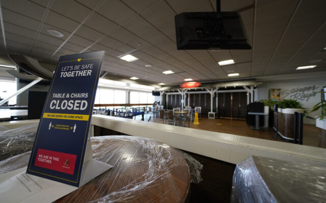 Daniel K. Inouye International Airport interland terminal restaurant sign outlining the tables and chairs are closed during COVID-19 pandemic. September 23, 2020