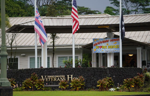 An American flag flies at half mast at the main entrance of the Yukio Okutsu Veterans Home located on Hawaii island during a COVID-19 pandemic. Scores of veteran residents have died while in care of the veterans home. September 24, 2020