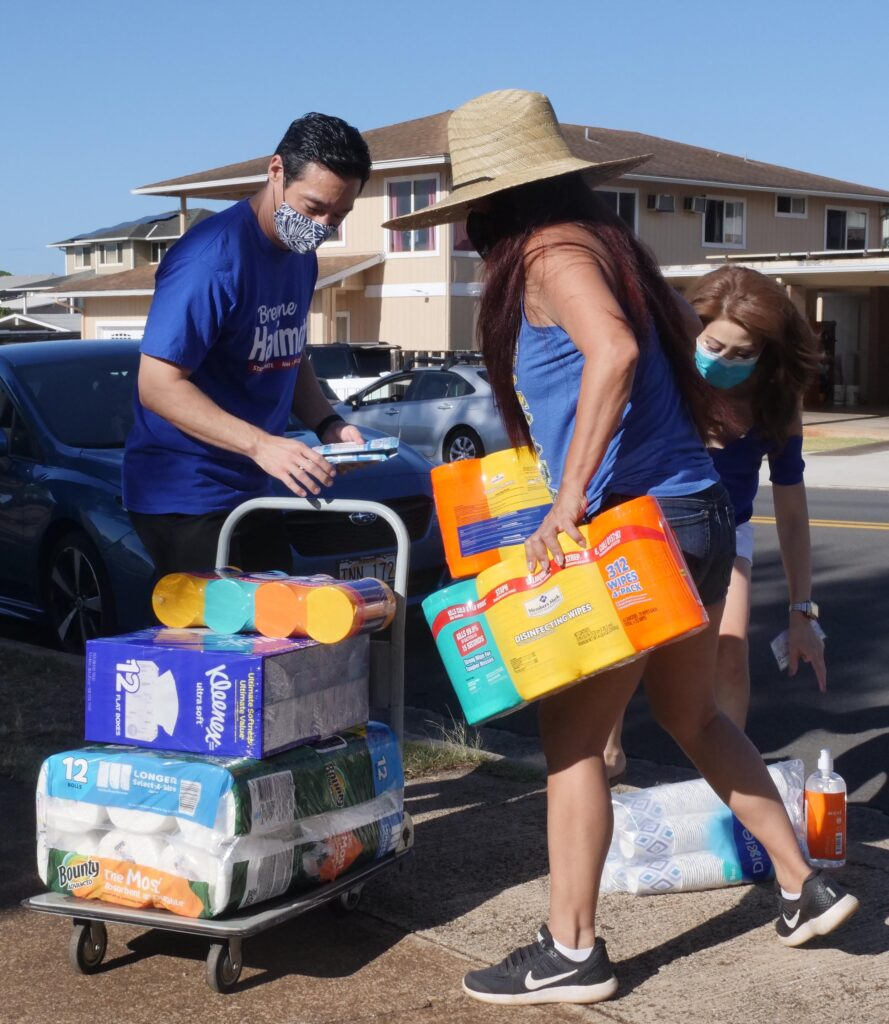 Volunteers loading cleaning supplies during inaugural senator Breene Harimoto school supply fund drive in Pearl City.  Sunday, Sept. 26, 2020. (Photo: Ronen Zilberman/Civil Beat)
