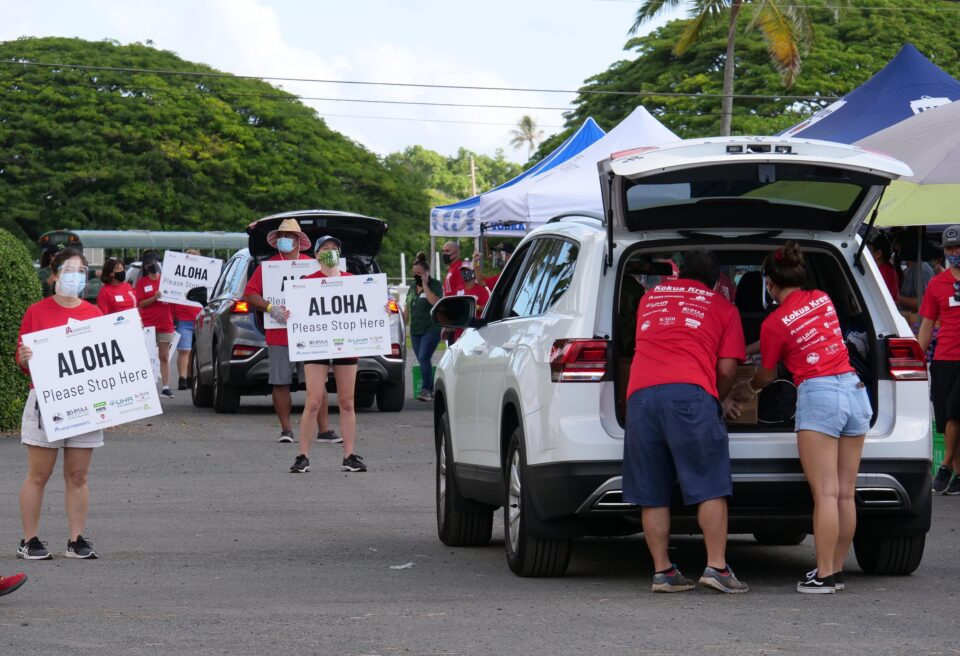 Volunteers loading boxes of food into a car during the ohana food pack pick up at Kualoa Ranch on Sunday, September 27, 2020.  The event was organized by Advantage Insurance Services Inc. and Aloha Harvest. (Photo: Ronen Zilberman/Civil Beat)