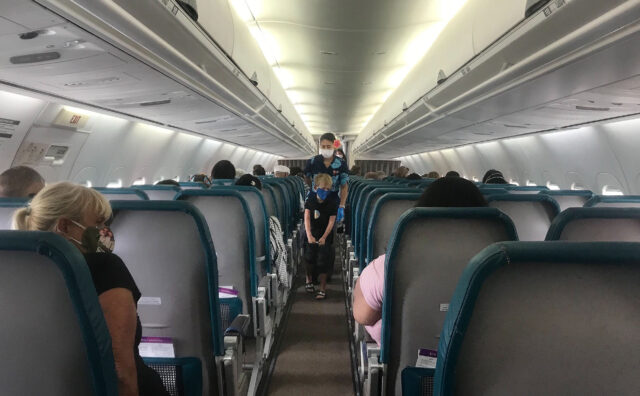 Passengers are socially distanced on a Hawaiian Airlines flight during COVID-19 pandemic.