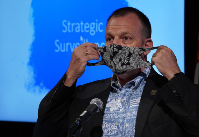Lt Governor Josh Green gestures with his mask during press conference held at the Hawaii Convention Center on requiring arriving passengers to have a COVID-19 test before arriving to Hawaii. October 1, 2020