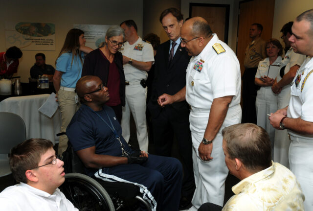 Vice Adm. Adam M. Robinson Jr., Surgeon General of the Navy and Chief of the Navy Bureau of Medicine and Surgery speaks with a wounded warrior at the Lakeshore Foundation in Birmingham, Ala. Lakeshore Foundation recently began a wounded warrior transitioning program called Lima Foxtrot. This event is one of many events held in conjunction with Birmingham Navy Week. Navy Weeks are designed to show Americans the investment they have made in their Navy and increase awareness in cities that do not have a significant Navy presence.