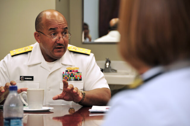 Vice Adm. Adam M. Robinson Jr., Surgeon General of the Navy and Marine Corps and Chief of the Navy Bureau of Medicine and Surgery, speaks with Naval Construction Battalion Center, Gulfport Branch Medical Clinic's leadership as part of a Gulf Coast regional tour of various Navy medical facilities. The surgeon general is on a fact-finding tour gathering feedback about local Navy medicine issues and its support to force readiness.