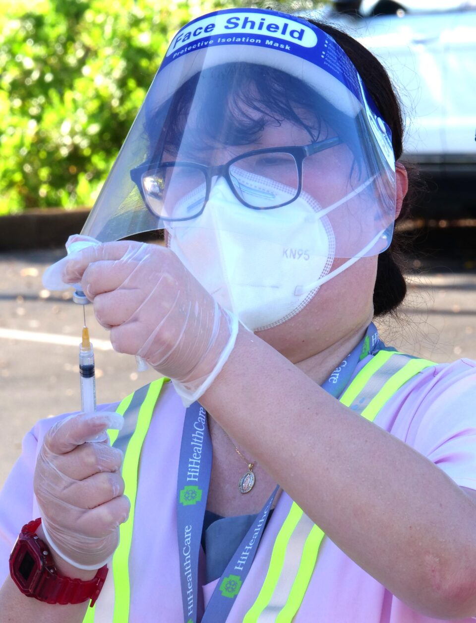 A volunteer prepares flu shots to be administered during a free drive-thru flu shot clinic at the Kaka'ako district park Saturday, Oct. 3, 2020. (Ronen Zilberman photo Civil Beat)