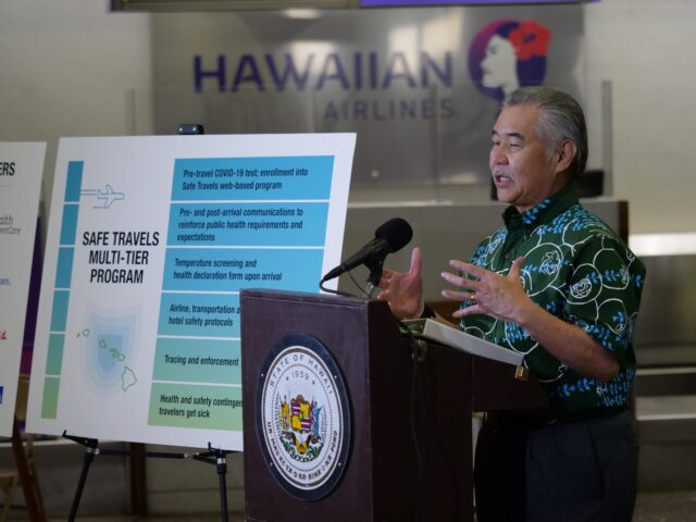Hawaii Govenor David Ige gestures as he gives a media briefing Tuesday, Oct. 7, 2020 in Honolulu, HI. The briefing was held to unveil new COVID-19 safety measures the state plans to implement upon re-opening to travelers on October 15th. (Ronen Zilberman photo Civil Beat)