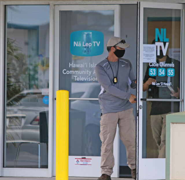 An FBI agent walks out of the main entry of Na Leo 'O Hawaii public access television. The FBI conducted a search of the Hilo facility on Thursday. Photo: Tim Wright