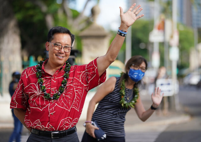 Mayoral Candidate Keith Amemiya and wife Bonny Amemiya wave at cars while campaigning along King Street. October 12, 2020