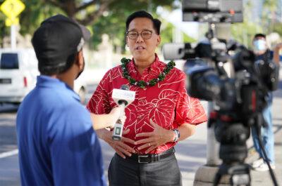 Mayoral candidate Keith Amemiya interviewed at campaign rally along King Street. October 12, 2020