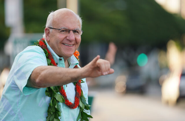 Honolulu mayoral candidate Rick Blangiardi flashes the shaka to oncoming motorists along Beretania Street fronting the Capitol. October 13, 2020