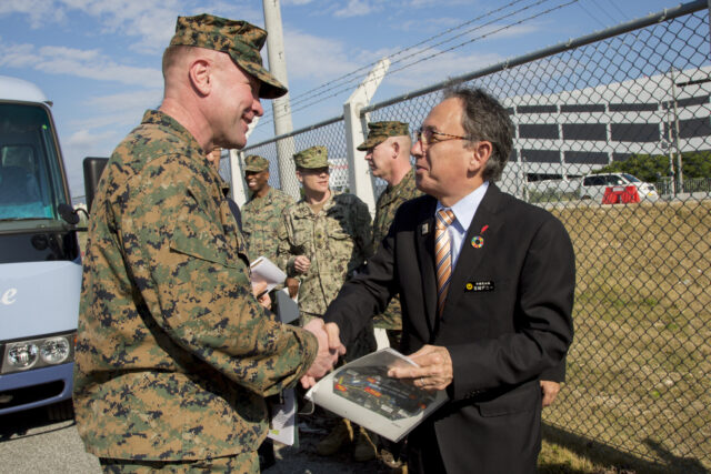 U. S. Marine Corps Brig. Gen. Christopher McPhillips, deputy commanding general of III Marine Expeditionary Force, thanks Okinawa Governor, Denny Tamaki with a hand shake during a tour on Camp Kinser, Okinawa, Japan, Jan. 31, 2019. During the tour, members of the party were shown various buildings and tracts of land designated to be returned to the Government of Japan as part of the consolidation and relocation project. (U.S. Marine Corps photo by Lance Cpl. Nicole Rogge)