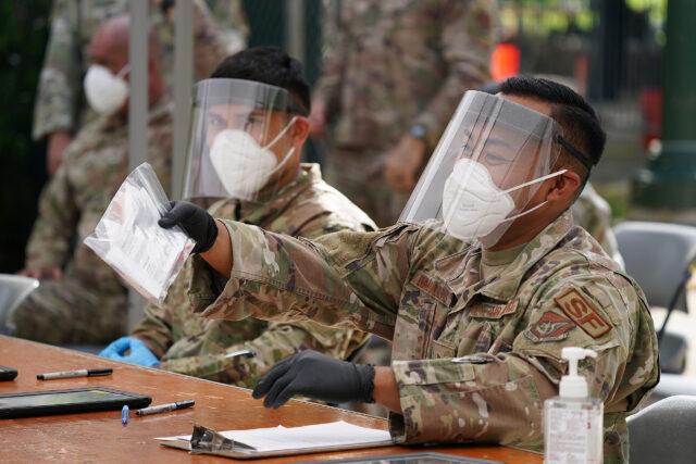 Hawaii Army National Guard members assist with free COVID-19 testing held at the Waikiki Shell. October 16, 2020