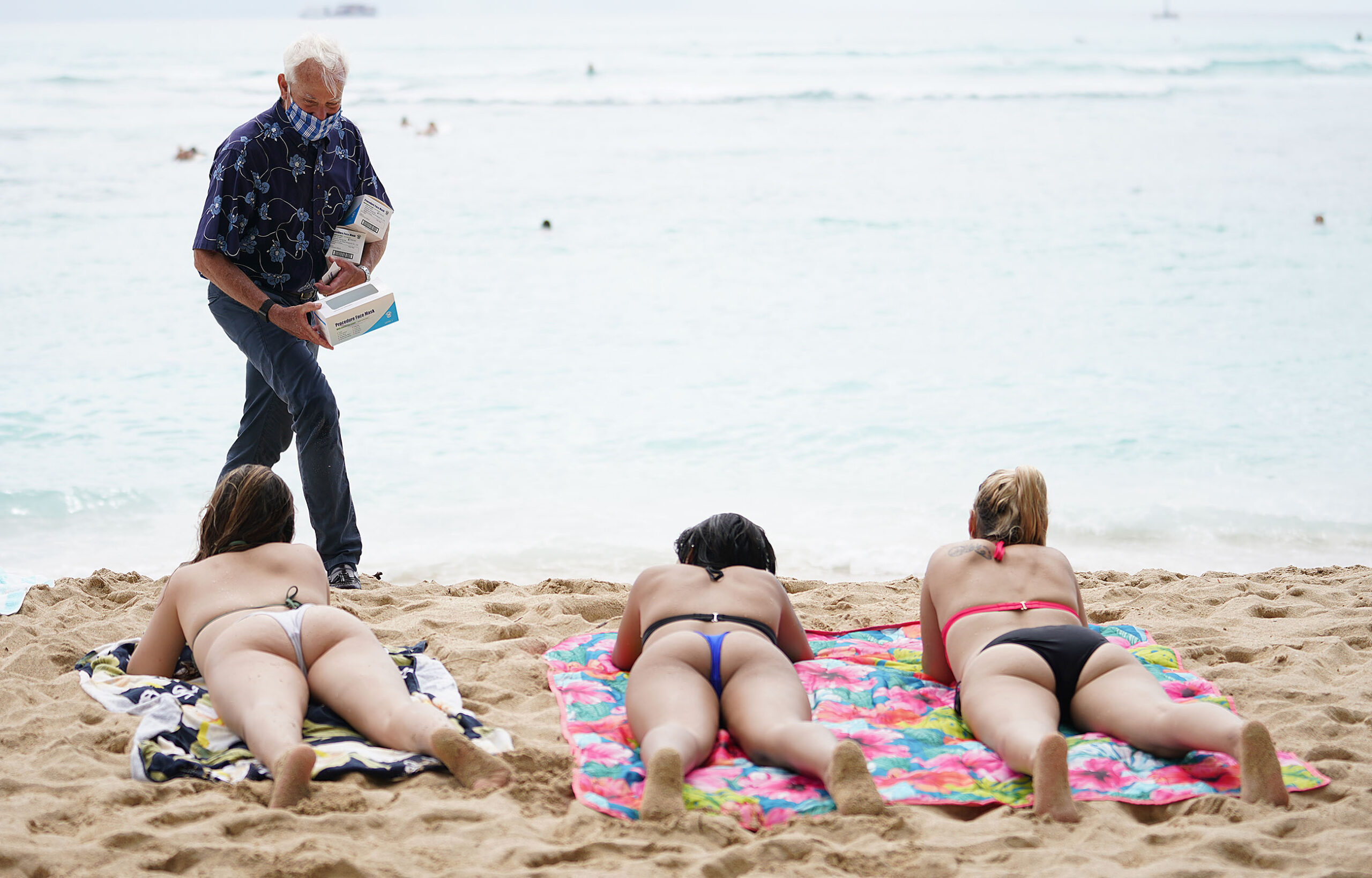 <p>Honolulu Mayor Kirk Caldwell gave out free paper masks to visitors at Waikiki's Kuhio Beach during the pandemic after Hawaii reopened to visitors in October through a pre-travel testing program. The state's biggest industry has slowly started to rebound.</p>