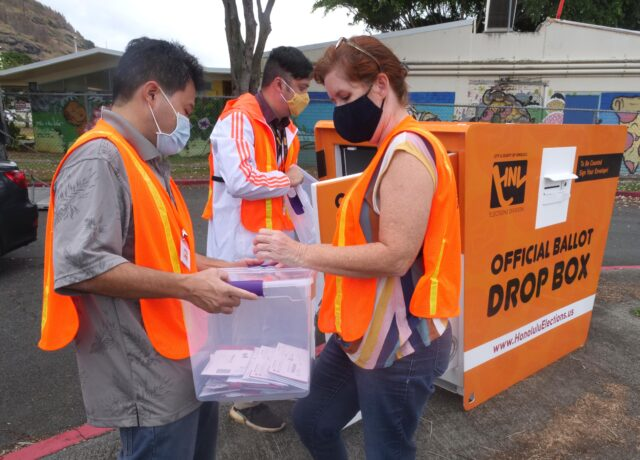 Election workers collect ballots from an official ballot drop box at the Kalihi District Park on Wednesday, October 21, 2020. (Ronen Zilberman photo Civil Beat)