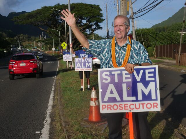 Candidate for Honolulu Prosecutor, Steve Alm, waves to cars on the Pali Hwy Thursday evening in Honolulu, HI, October 22, 2020. (Ronen Zilberman photo Civil Beat)