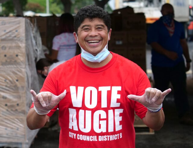 Local celebrity and City Council candidate for district 9, Augie Tulba, volunteers during a food distribution event at Aloha Stadium, Friday, October 23, 2020.